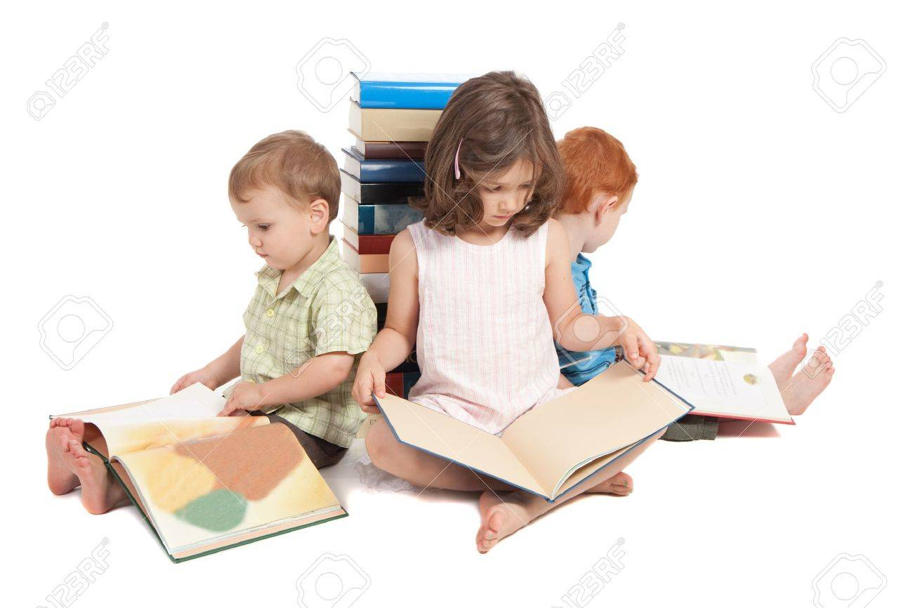 Three kids sitting on floor reading books and leaning against stack Isolated on white - 15155166