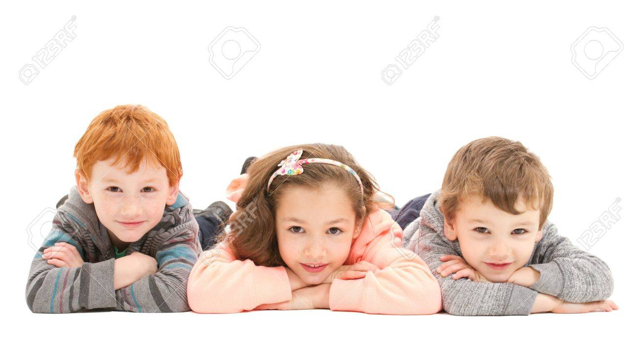 Three kids laying on floor. Isolated on white. - 20174583