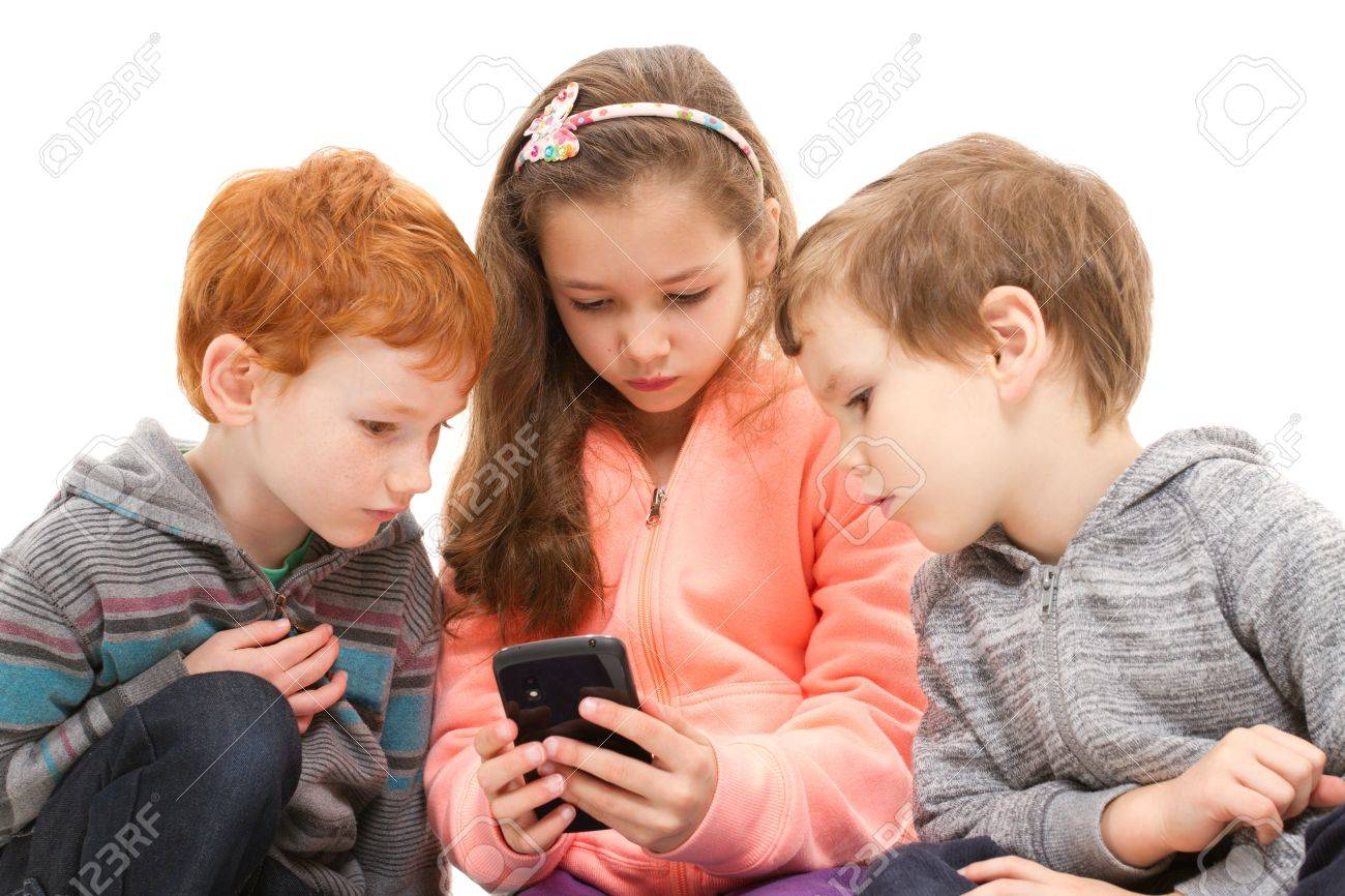 Group of kids using black smartphone. Isolated on white. - 20174571
