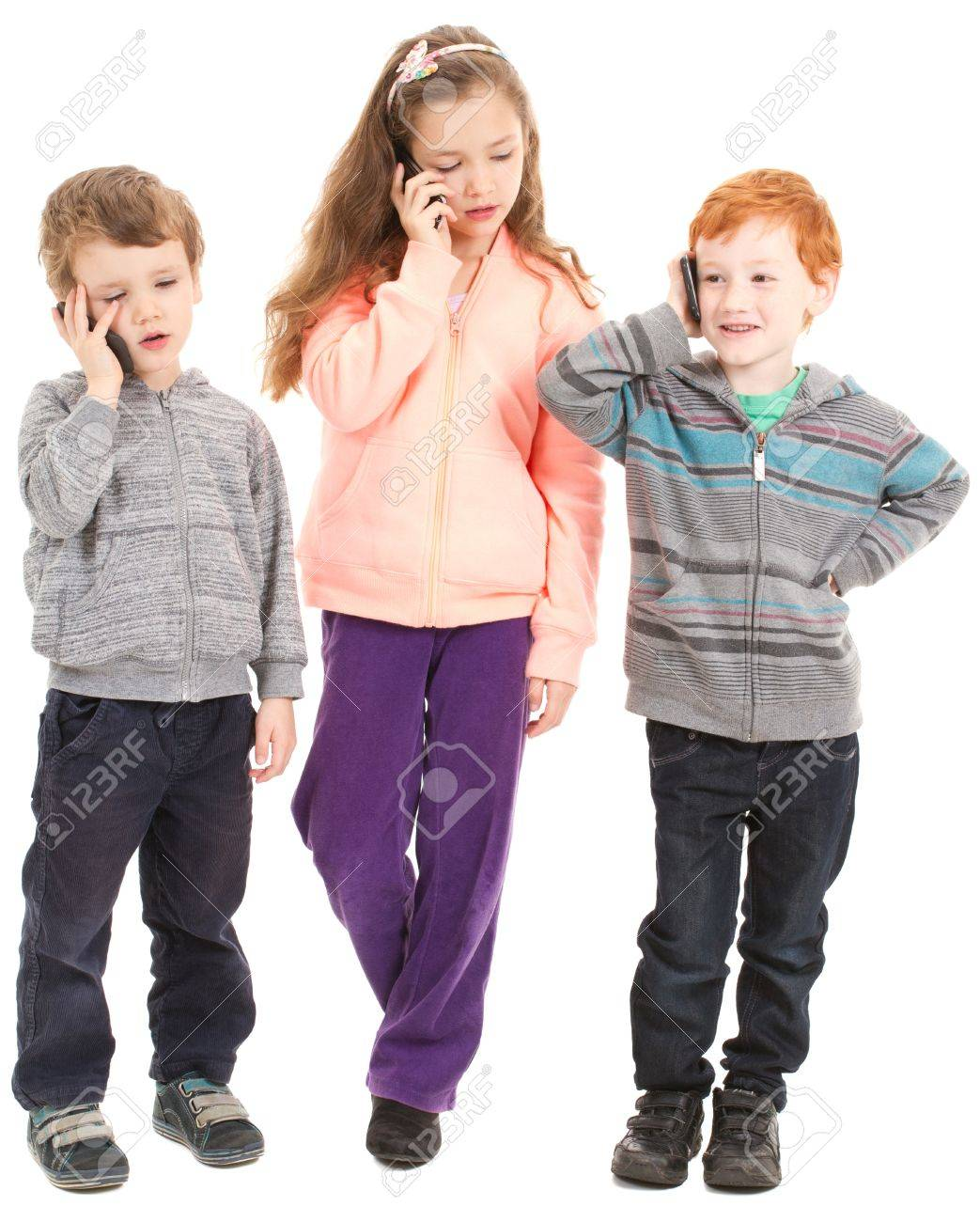Group of three children talking on kids mobile phones. Isolated on white. - 20174631