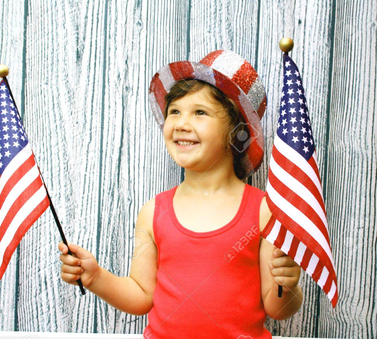 Young girl with 4th of july hat and flags Stock Photo - 5019354