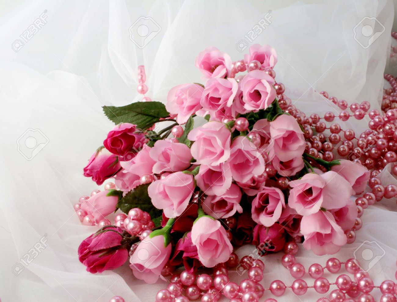 Bunch Of Pink Roses On White Lace Stock Photo Picture And Royalty