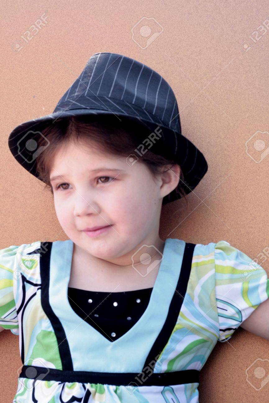 fbe1c6fa2d6 cute little girl in a fedora hat Stock Photo - 6788868