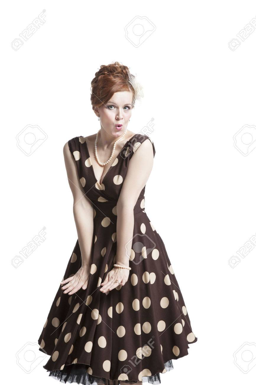 b2fe24a11c5 Retro woman in vintage polka dots dress