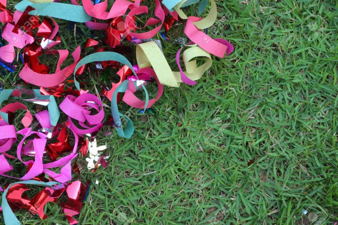 Scrap ribbon on green grass Stock Photo - 16893793
