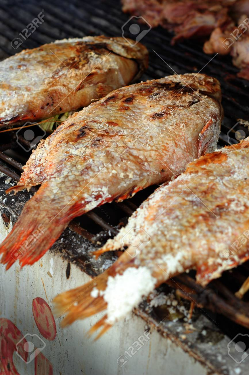 Salt fish - on the stove. Stock Photo - 23343450