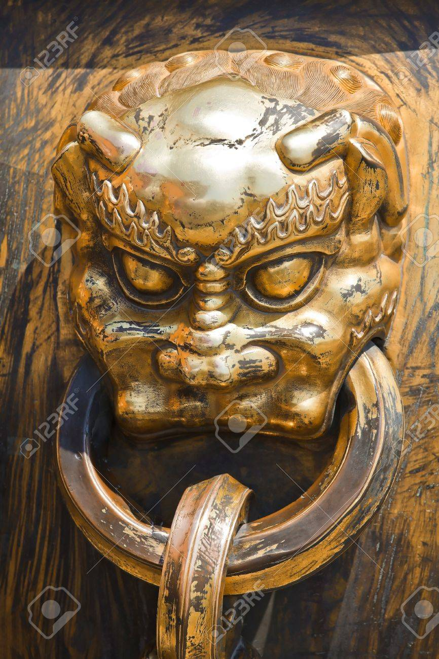 Ancient bronze lion as a handle in China Emperor Forbidden City Stock Photo - 7219676