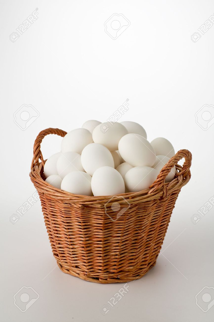 White eggs in wicker basket isolated Stock Photo - 6675670