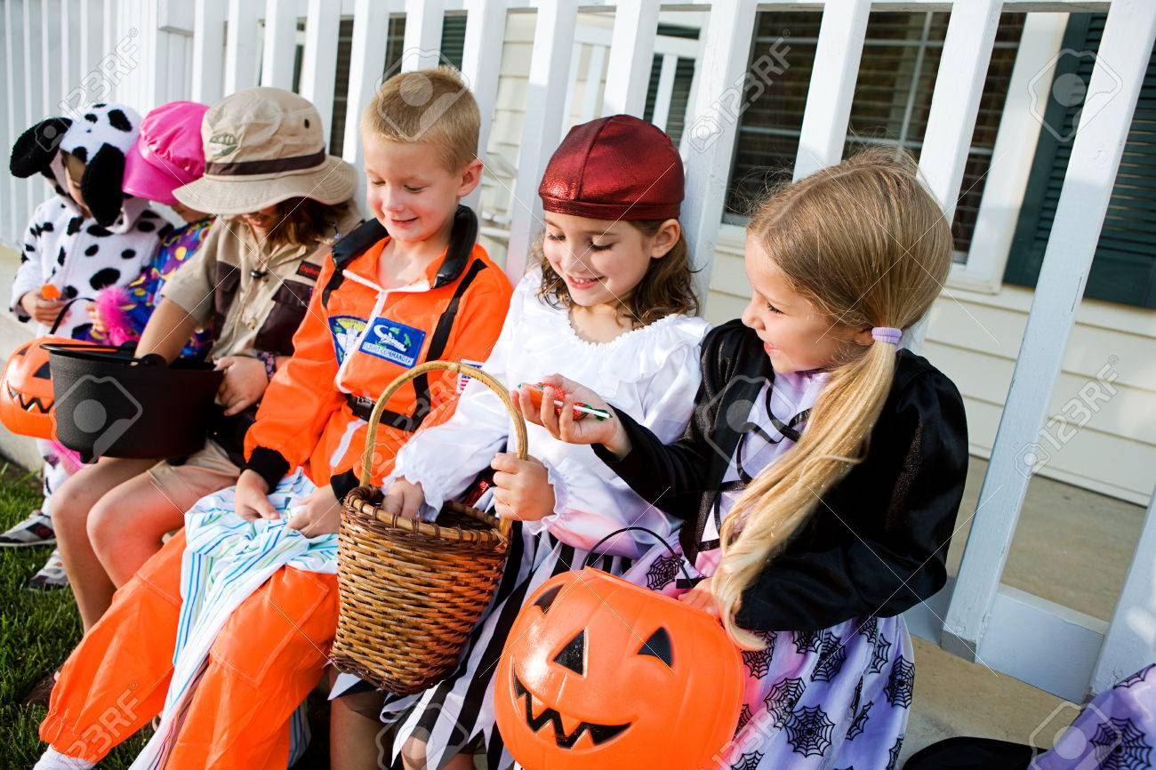 halloween kids comparing halloween candy stock photo 60514299 - Halloween Candy Kids