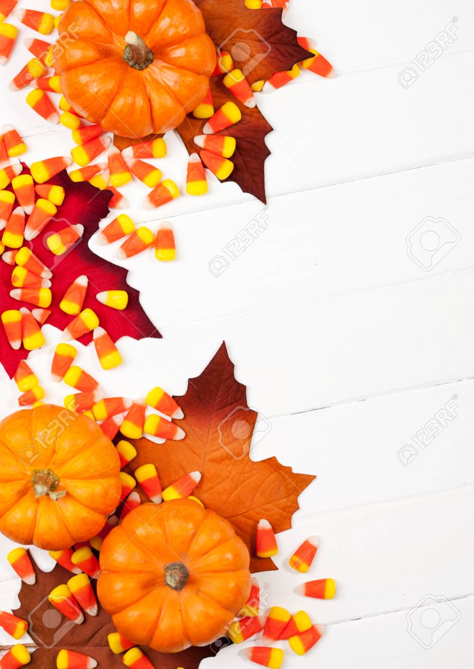 autumn fun halloween holiday candy and pumpkin background stock