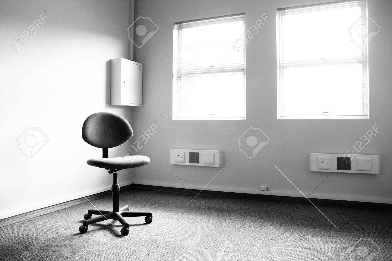 Black and white chair photography - Black And White Image Of A Single Office Typist Chair In An Empty Office Stock Photo