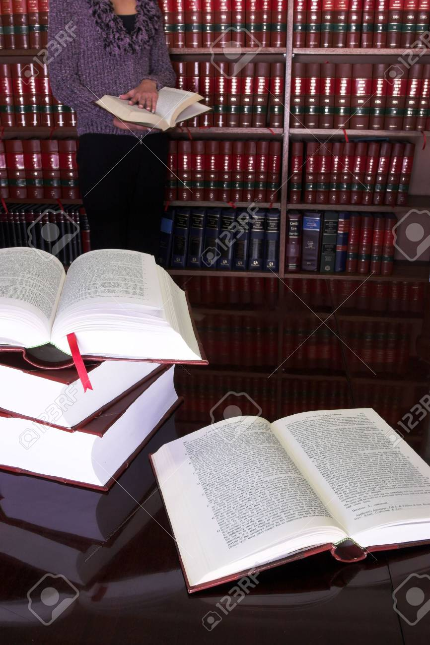 Legal books on table - South African Law Reports, Intern doing research Stock Photo - 232296