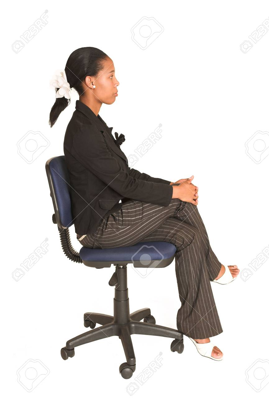 African business woman dressed in black jacket.  Sitting on office chair. Stock Photo - 277603