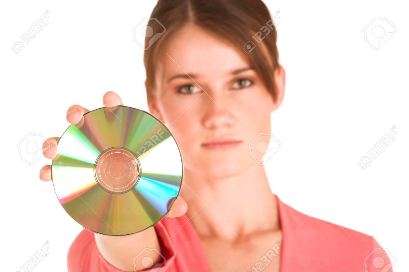 Brunette business woman in  an informal light pink shirt.  Holding a CD Stock Photo - 325885