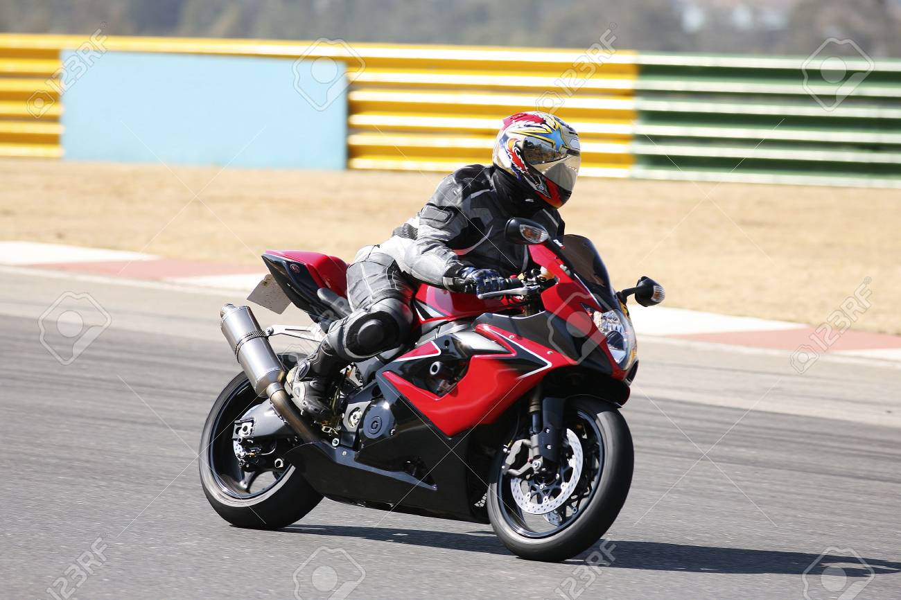 High speed Superbike on the circuit � Kyalami, South Africa � Movement on elements of the image. Trackday (all Logos and Trademarks removed) Stock Photo - 526547