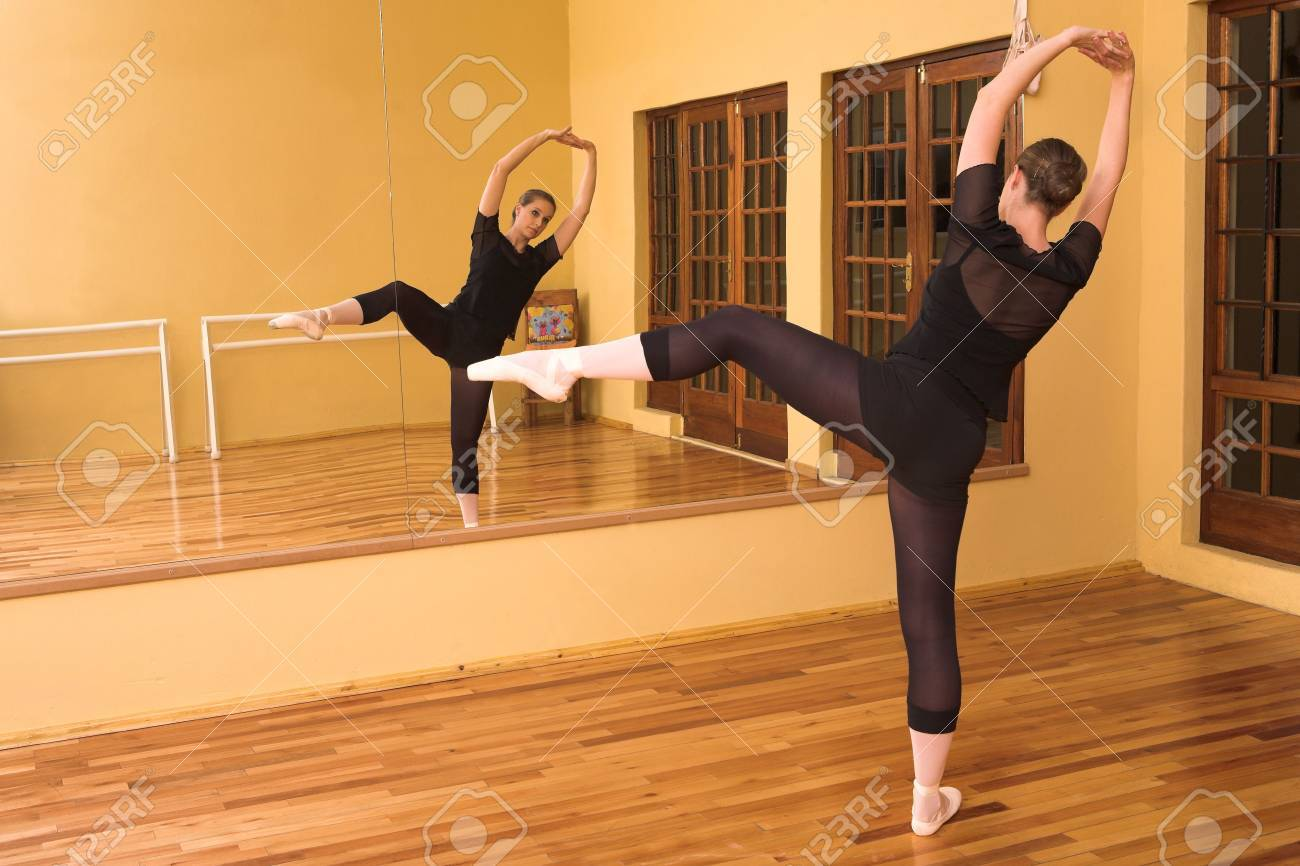 Ballerina dancing in studio Stock Photo - 591510