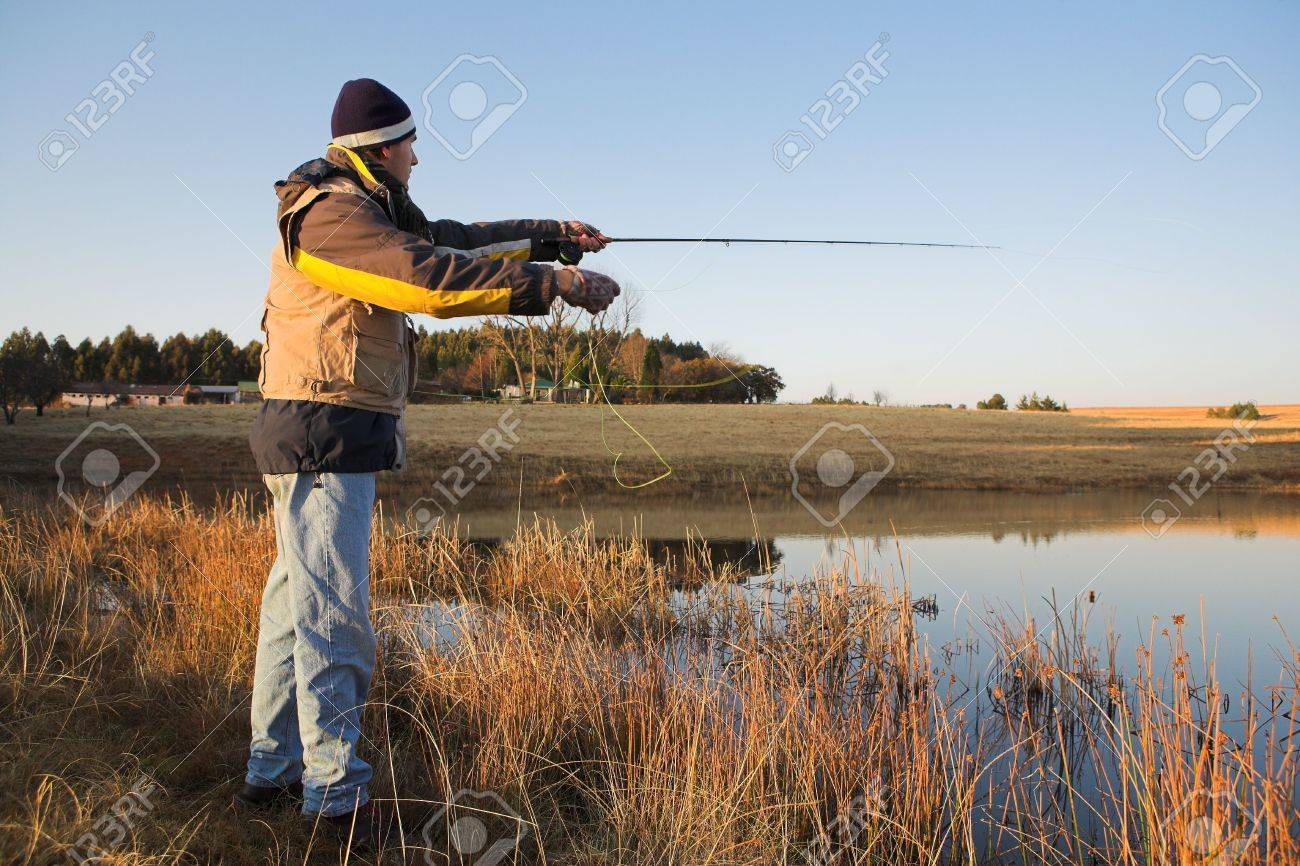 Fisherman Casting Line a Fly Fisherman Casting a Line