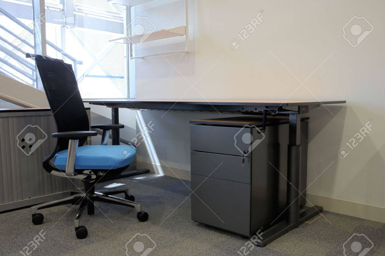 Empty office with new modern office furniture, including desks,..
