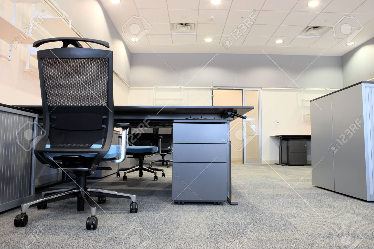 modern office cabinets. empty office with new modern furniture, including desks, cupboards, filing cabinets and