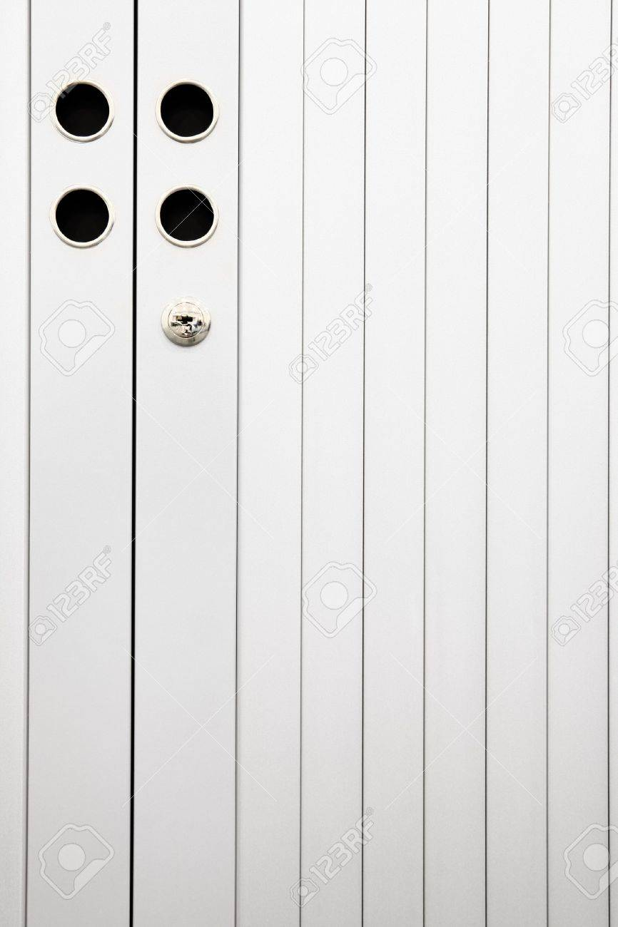 Slatted Doors Of A Closed And Locked Aluminum File Cabinet