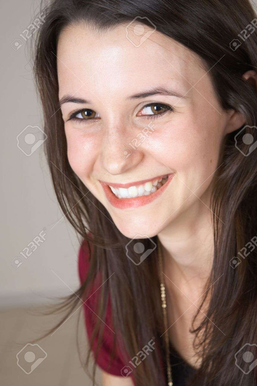 Portrait of a beautiful young adult (teenager) Caucasian woman with light skin and dark brown hair, brown eyes and pink lips, wearing a maroon Jacket. Shallow Depth of Field, focus on front eye Stock Photo - 2836047