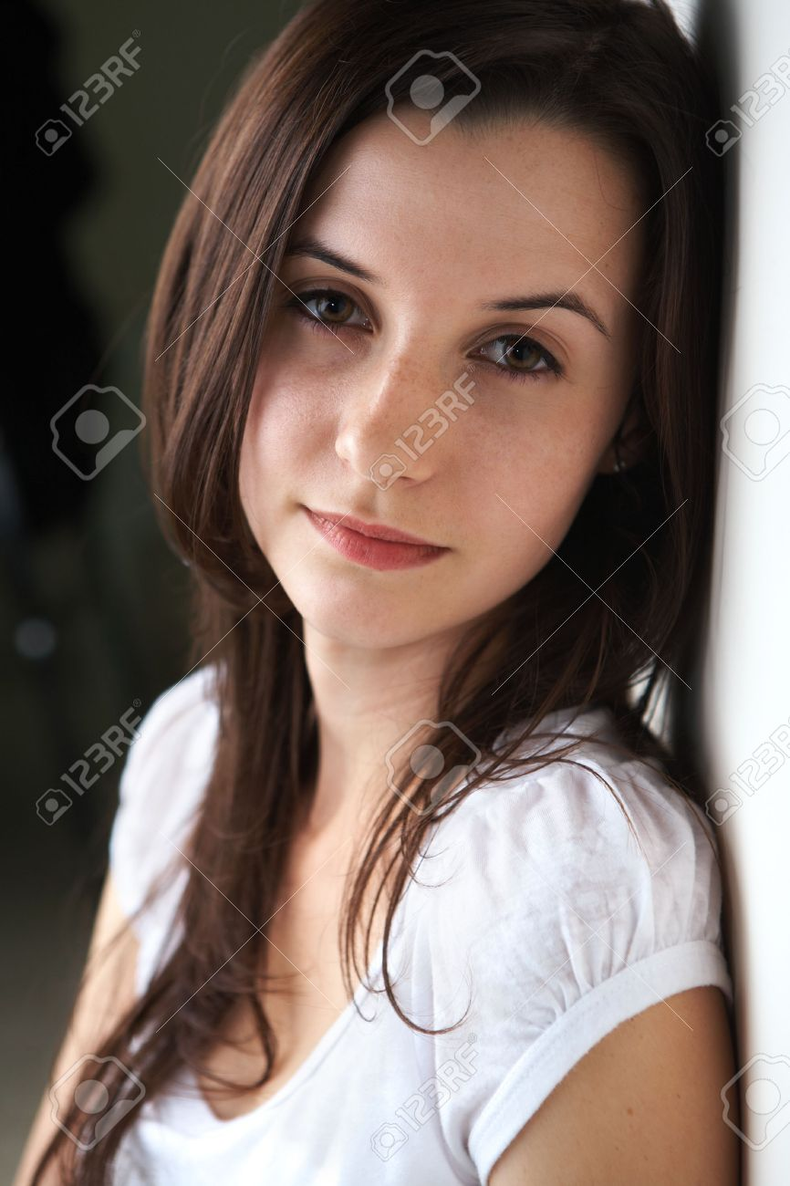 Portrait Of A Beautiful Young Adult (teenager) Caucasian Woman With Light  Skin And Dark