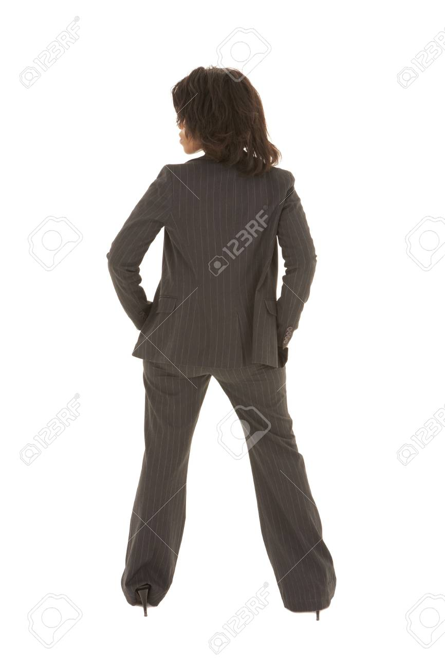 Young adult Caucasian businesswoman wearing a grey suit with curly brown hair on a white background. NOT ISOLATED Stock Photo - 3171453