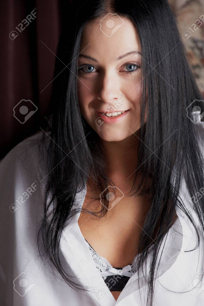 Sexy young adult Caucasian woman with black hair, smooth skin and blue contact lenses in her eyes. Stock Photo - 3233475