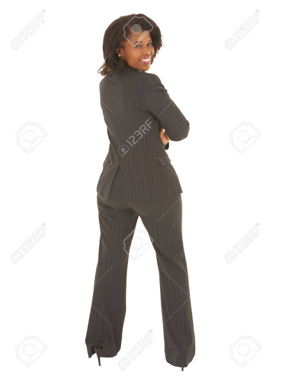 Sexy young adult african businesswoman in a business suit on..
