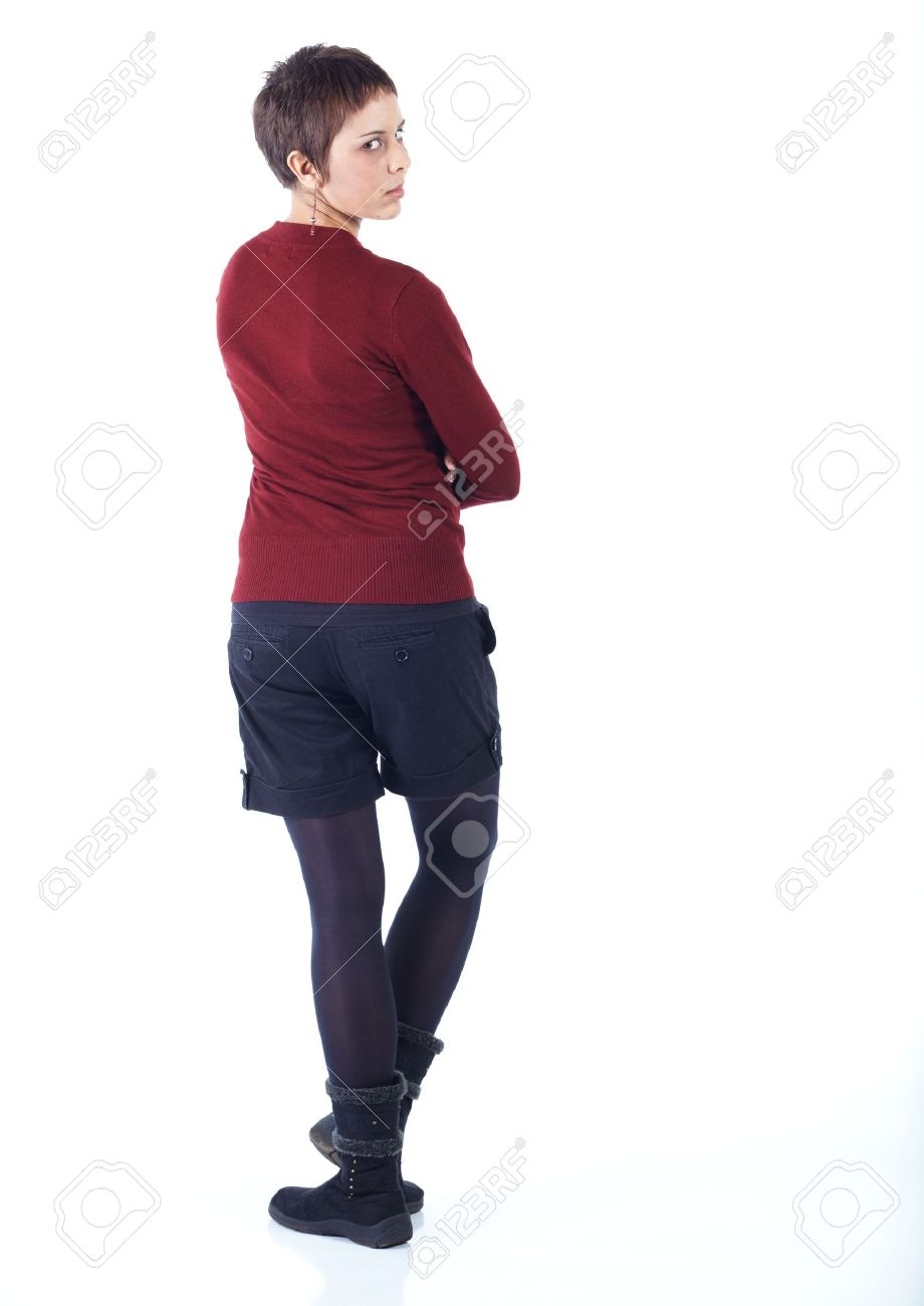 Cute young adult caucasian woman with short hair in a red top, black shorts and stockings on a white background in various poses, with various facial expressions. Not Isolated Stock Photo - 6605642
