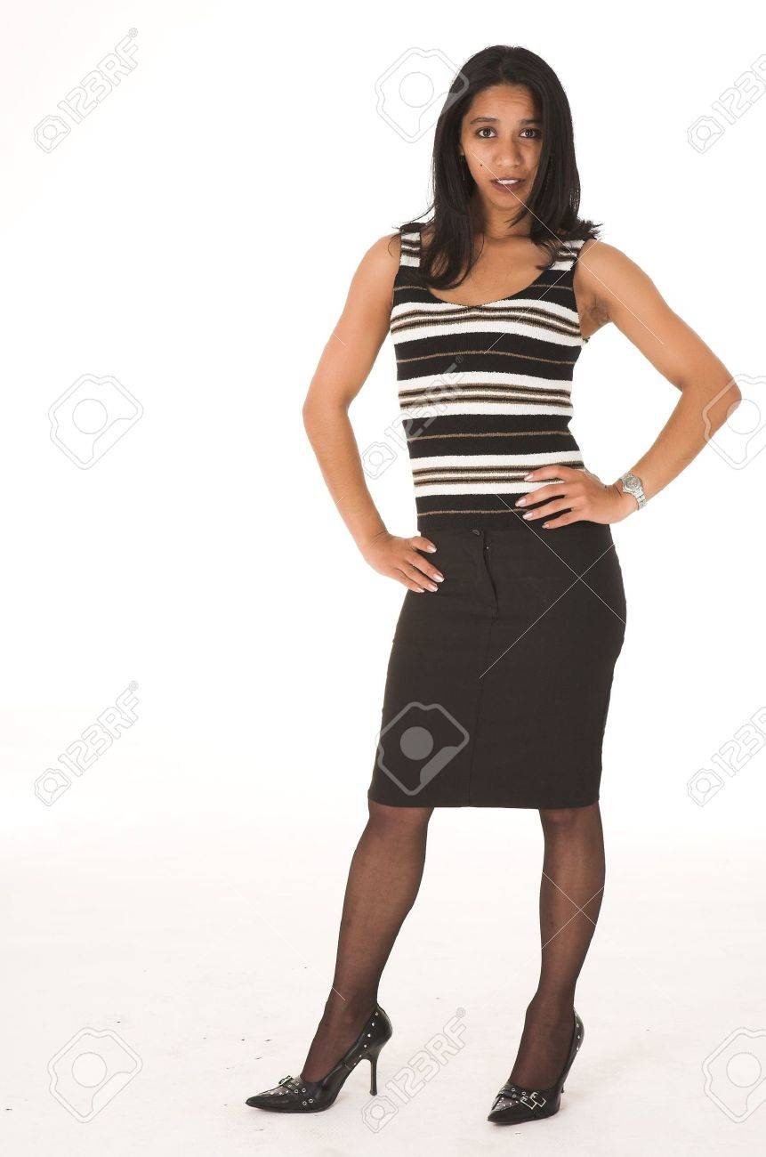 fce75dee3ed Stock Photo - Young adult African-Indian businesswoman in casual office  outfit with a black pencil skirt
