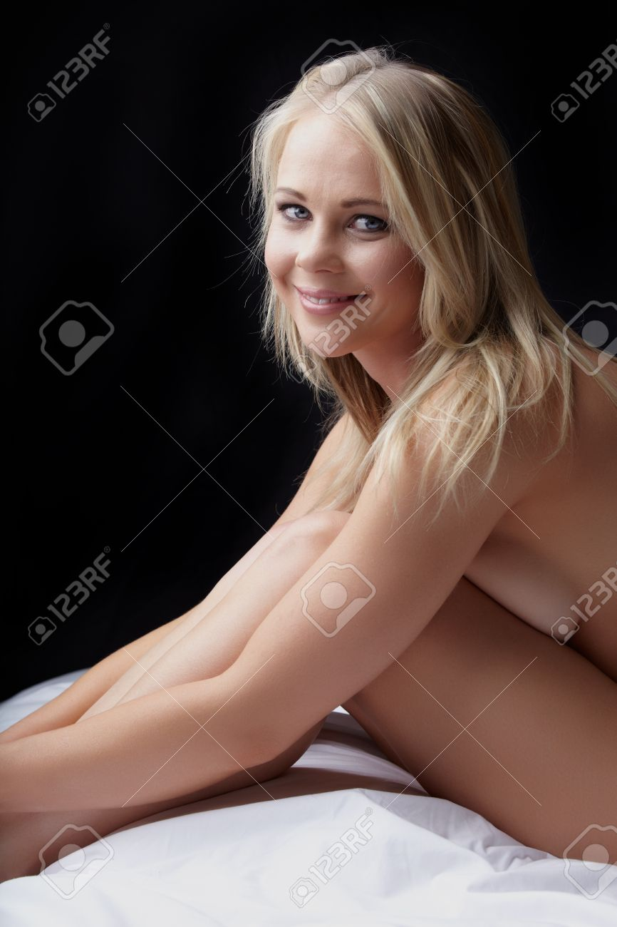 nude young adult caucasian woman with blonde hair and blue eyes