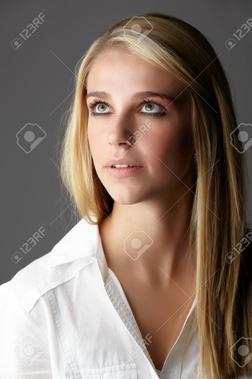 Young Adult Caucasian Woman With Long Blonde Hair And Green Eyes
