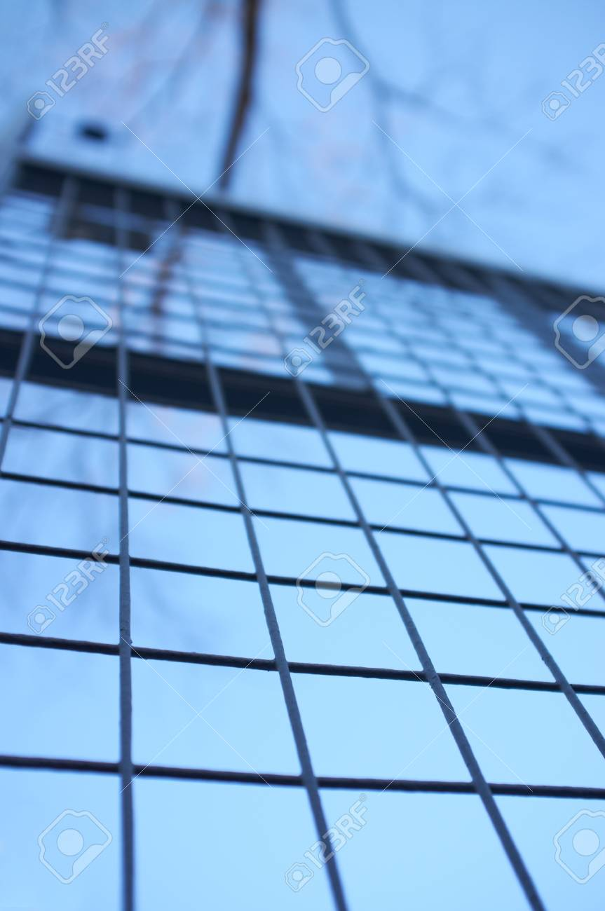 Tall welded fence against a blue sky Stock Photo - 17347053