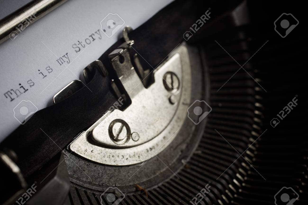 A Closeup image of the typebars and ribbon of an old style typewriter and paper with the text  My Story     Shallow Depth of Field  in a panorama crop Stock Photo - 17347084