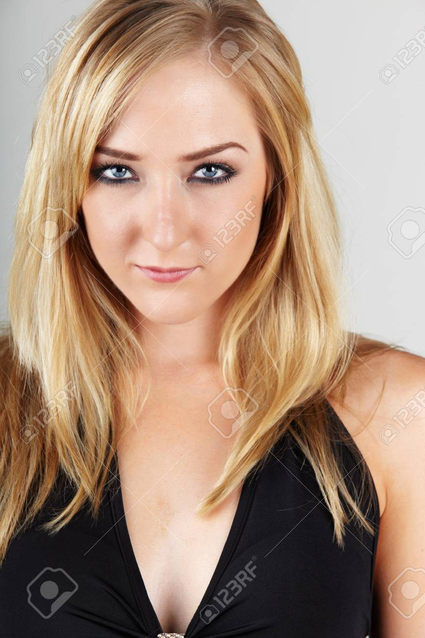 Beautiful young adult caucasian woman with blue eyes and shoulder length  blonde hair wearing a sexy