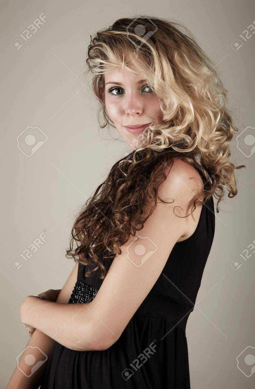 Beautiful Young Blonde Caucasian Woman With Long Curly Honey Stock Photo Picture And Royalty Free Image Image 19599946