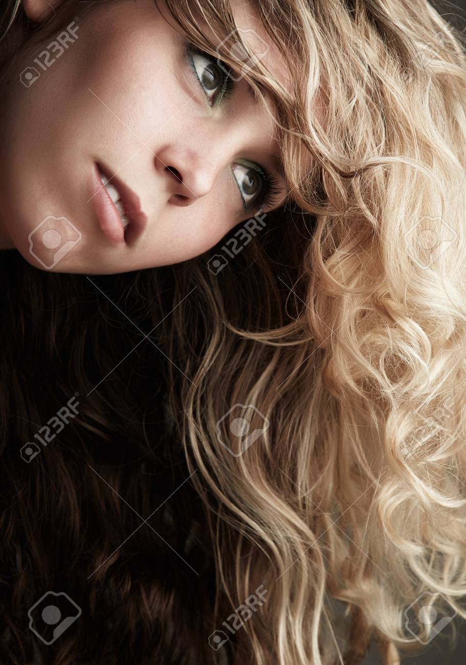 Beautiful Young Blonde Caucasian Woman With Long Curly Honey Stock Photo Picture And Royalty Free Image Image 19599416