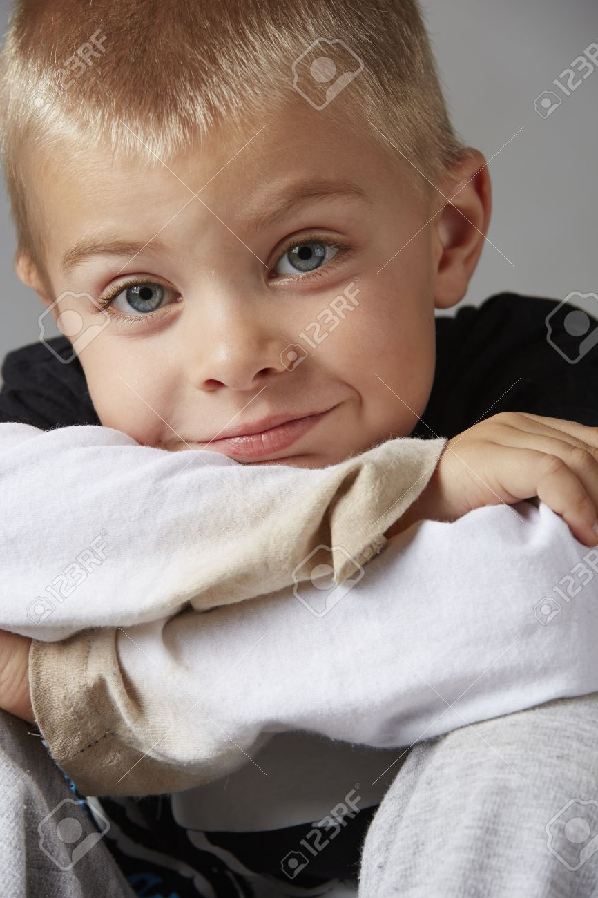 5 Year Old Caucasian Boy With Short Blonde Hair Blue Eyes And