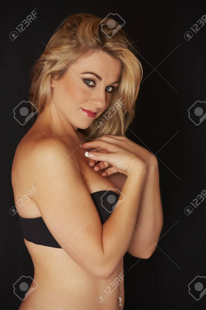 0e4a02ce43d Sexy and beautiful full figured young adult caucasian woman in black  lingerie against a black background