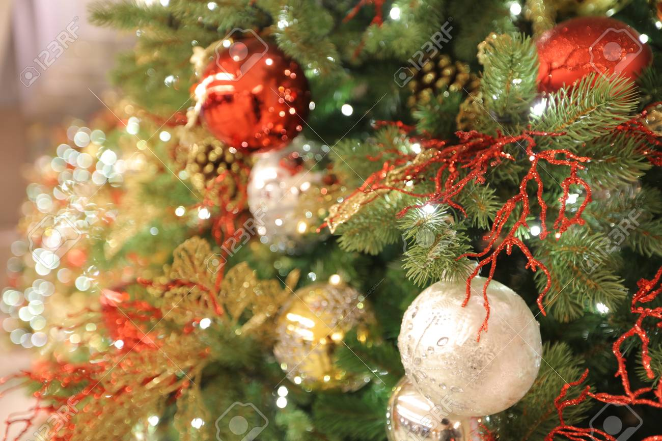 The Closeup Of Christmas Ornaments On Artifical Tree