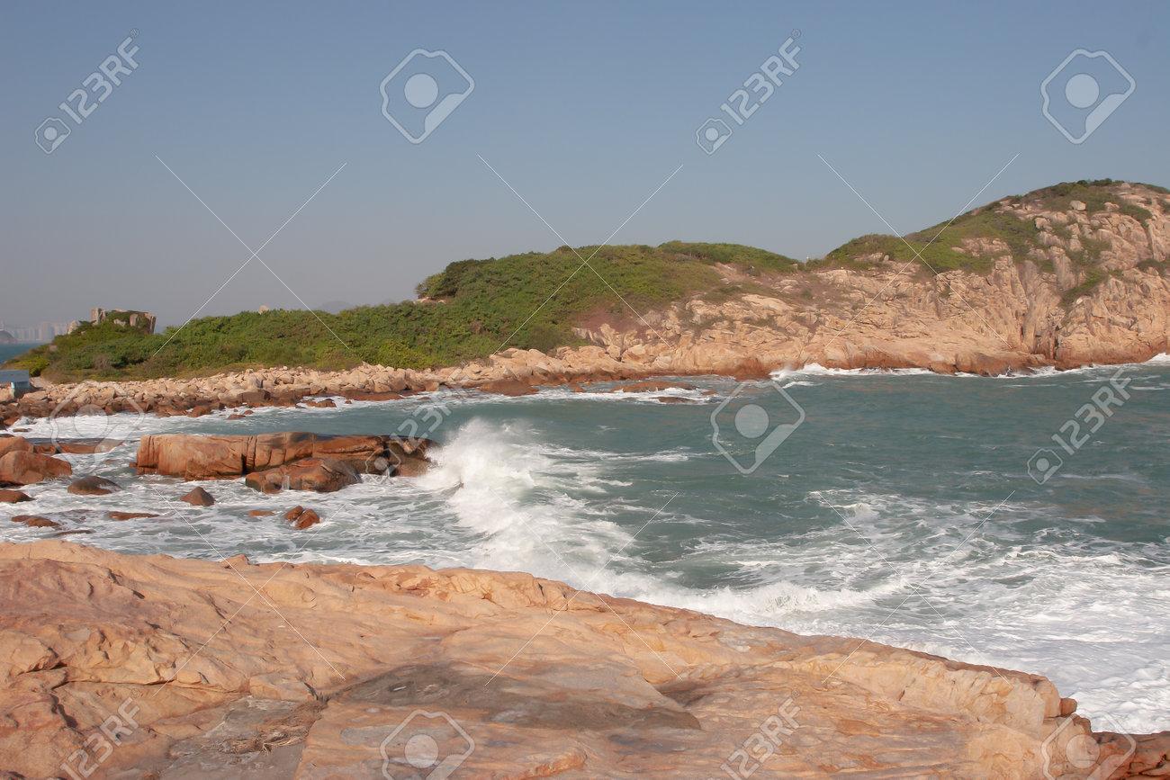a rocky sea coast and blurred water in shek o - 164735070