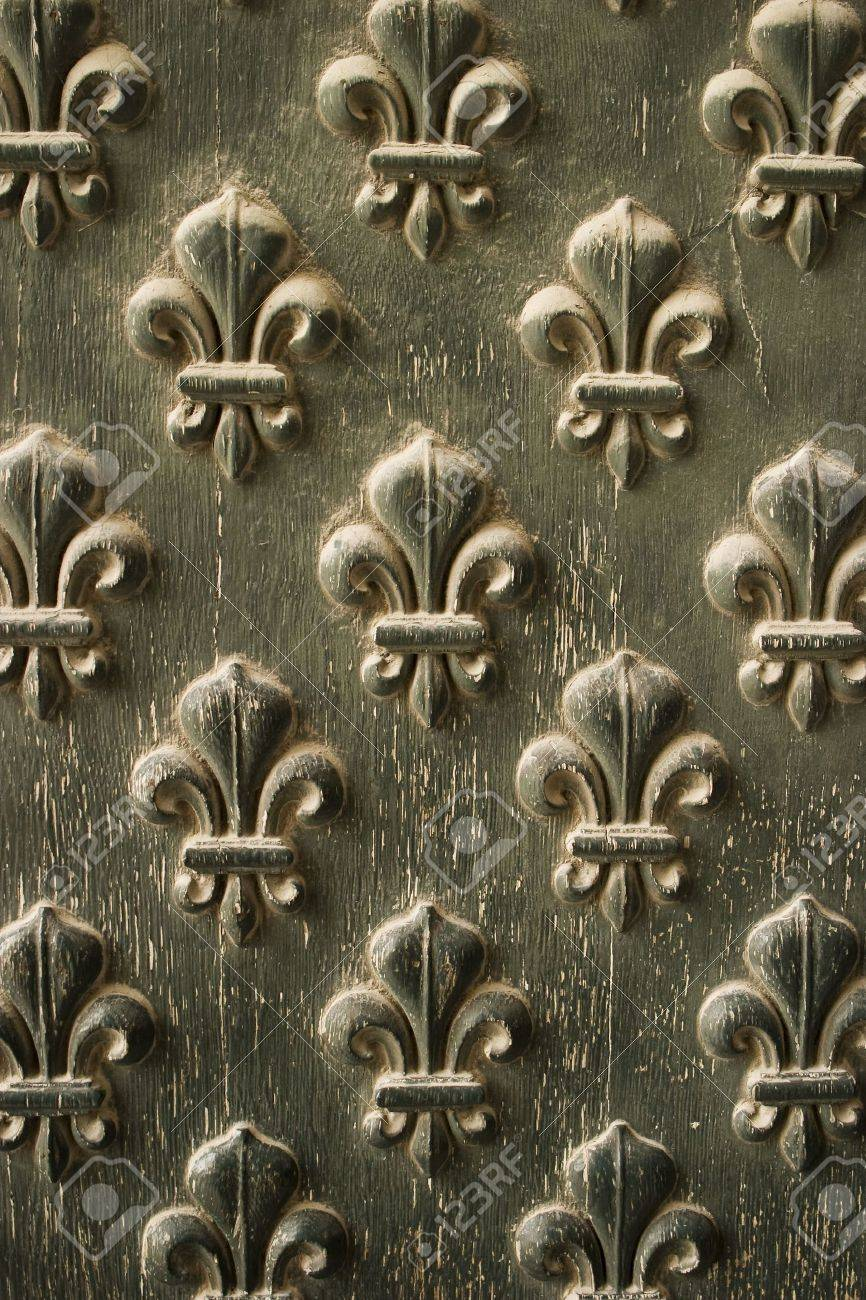 Fleur-de-lis pattern from the doors to Napoleon's Tomb in Paris. The paint is peeling due to weathering. Stock Photo - 1349796