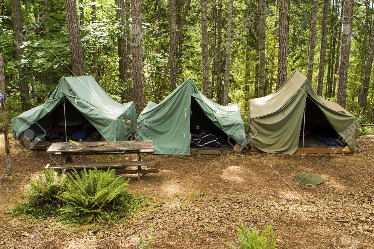 A group of canvas tents at a boy scout campground