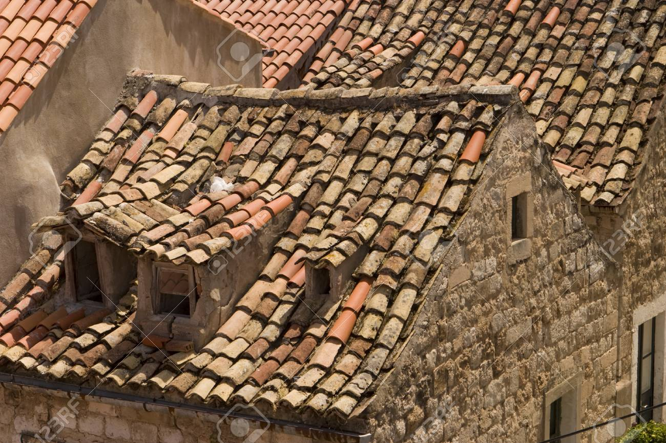 Old red tile rooftops in Dubrovnik are uneven and show interesting  character. These roofs show