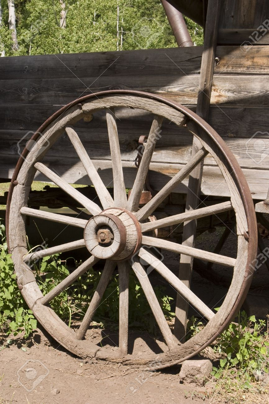 An Old Weathered Wagon Wheel In The American West Is An Example Of