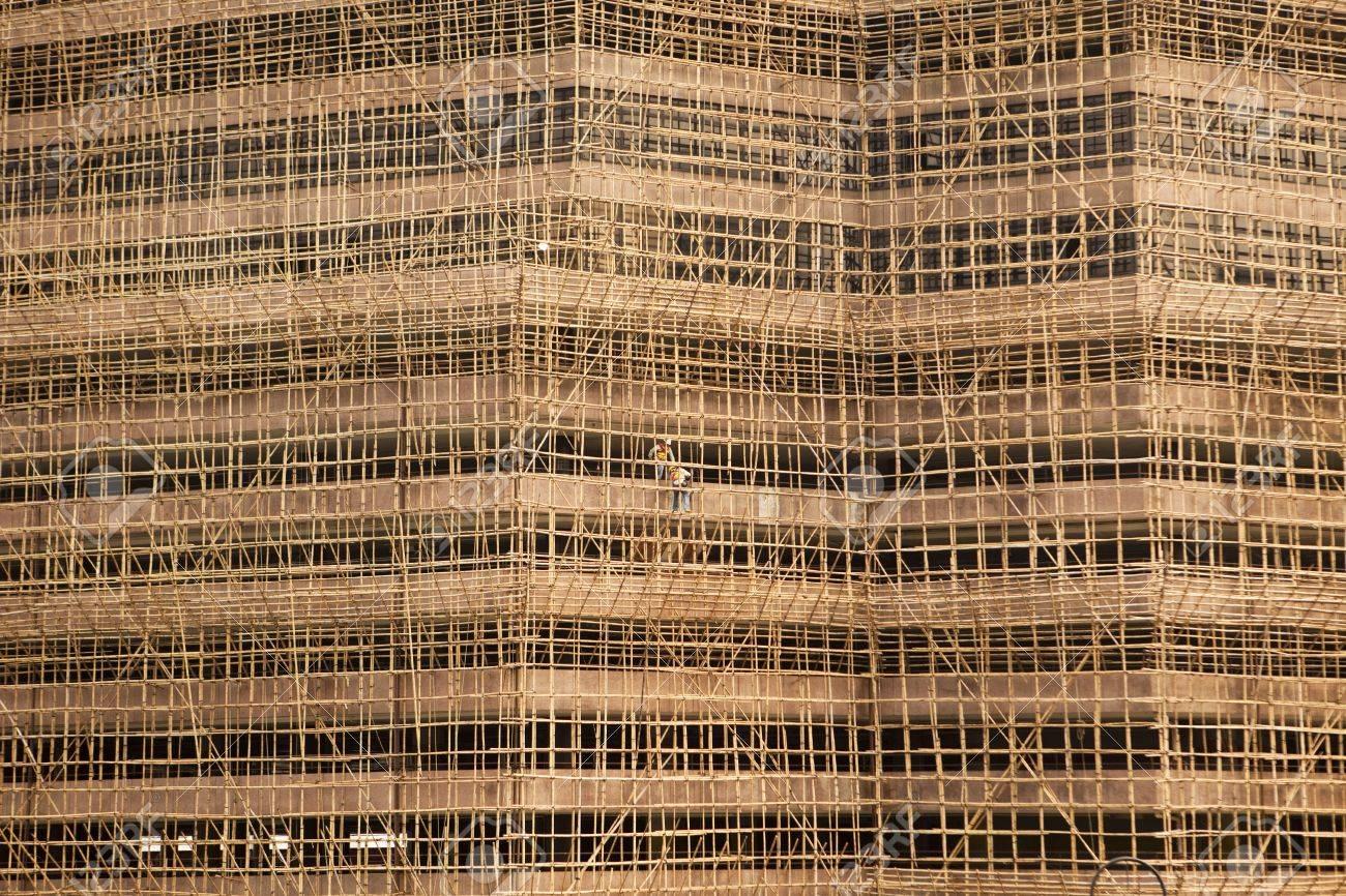 Un Edificio En Construcción En Hong Kong Se Enmarca Con Andamios ...