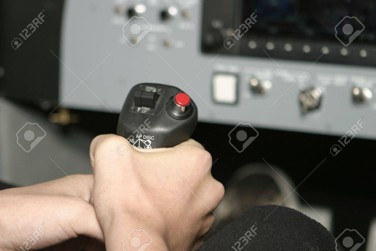 A hand gripping the controls for an aircraft. This photograph was taken in a flight simulator. Stock Photo - 7551153