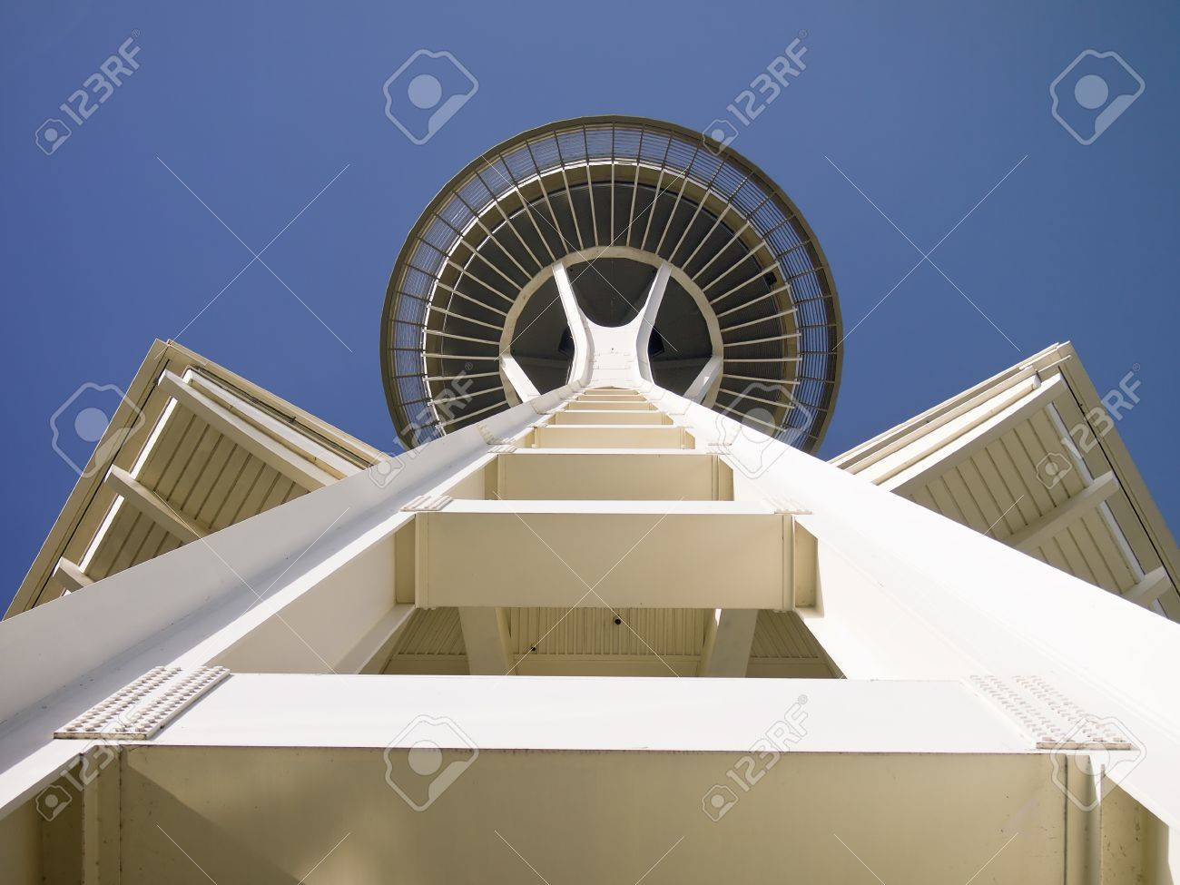 A view of the Seattle Space Needle as seen from 400 feet directly below the main structure. The lower observation deck extends on both sides. Stock Photo - 13574637