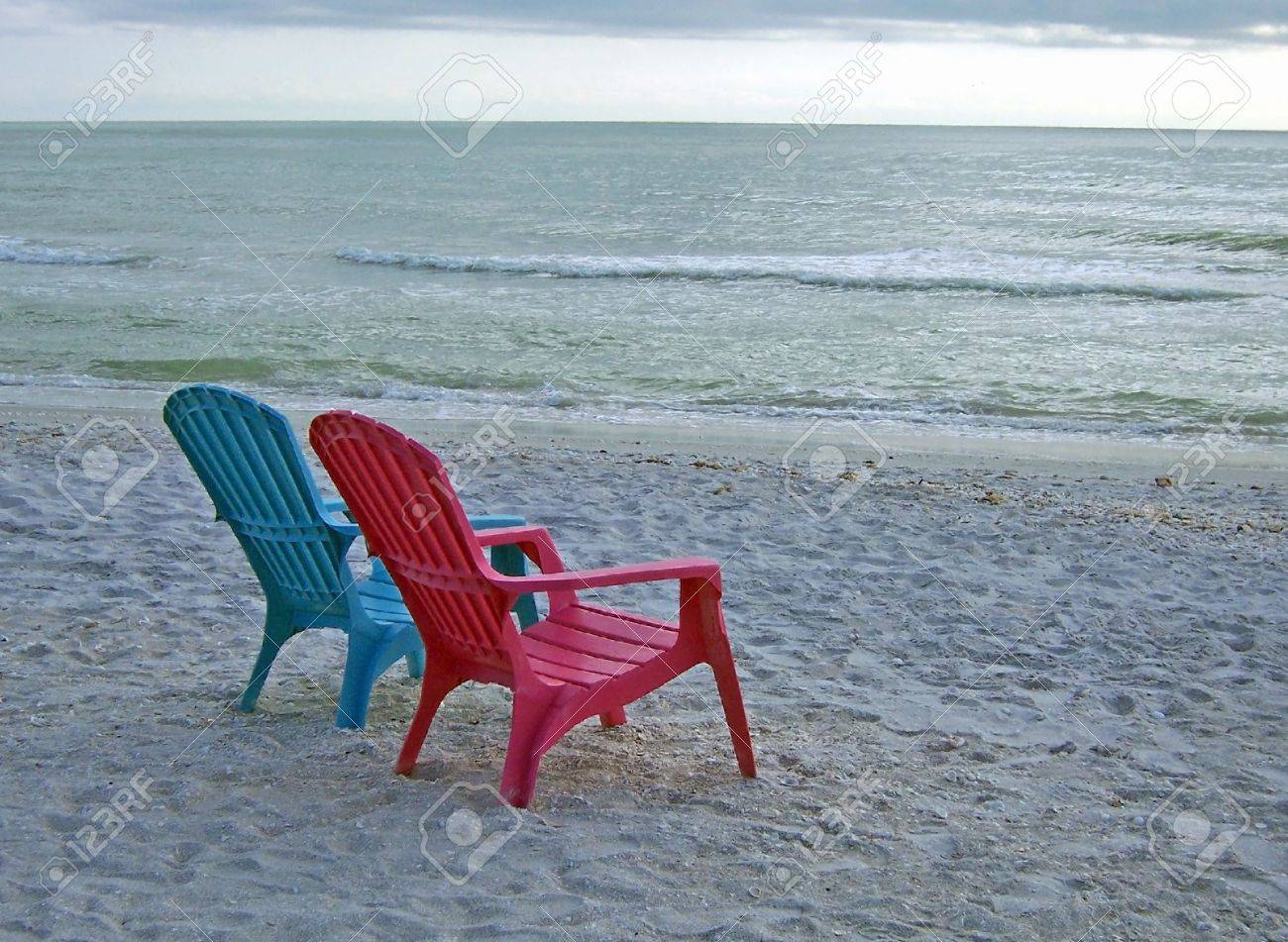 Delighful Adirondack Chairs On Beach Stock Photo Colorful Blue And Red Decorating